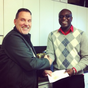 Les Talvio from the Cyrus Centre accepts a cheque from our Brand Marketing Manager, Paul Ackah-Sanzah