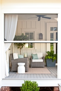 Executive motorized screens keep the bugs off the porch.
